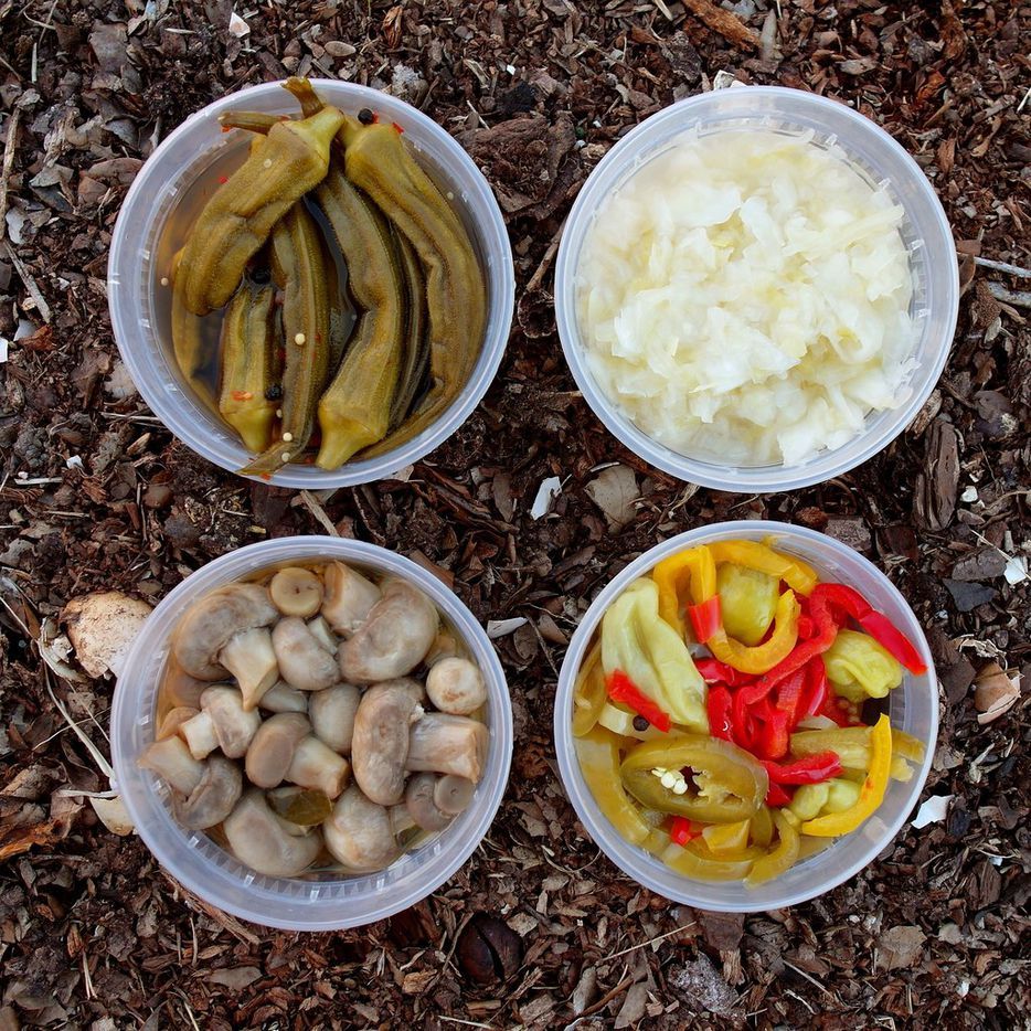Pickletopia is all about fresh, pickled foods, including (clockwise from top left): sweet-and-sour okra, traditional German sauerkraut, giardiniera and mushrooms.