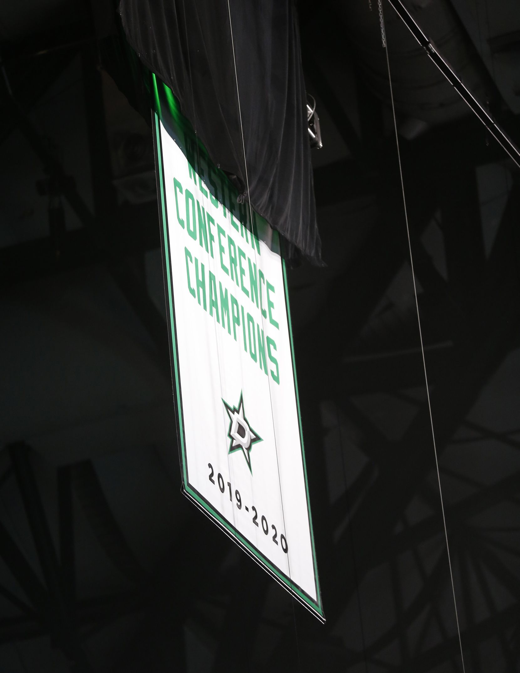 The Western Conference Champions banner is unveiled prior to the start of the game between the Dallas Stars and Nashville Predators at the home opener at American Airlines Center on Friday, January 22, 2021in Dallas. (Vernon Bryant/The Dallas Morning News)