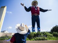 Isaiah Lee, 6, of Weatherford looks up at Big Tex at the State Fair of Texas on Friday, October 4, 2019 at Fair Park in Dallas.