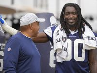 Dallas Cowboys defensive end DeMarcus Lawrence (90) laughs with sr. defensive assistant George Edwards during a practice at training camp on Saturday, July 31, 2021, in Oxnard, Calif.