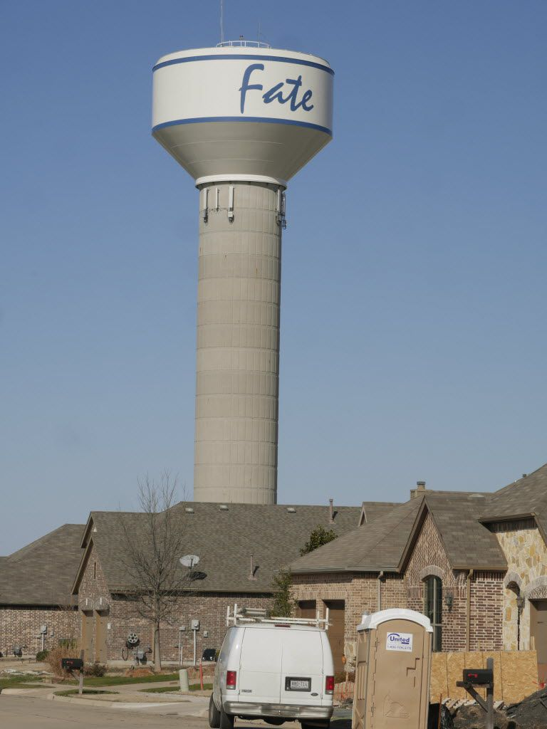A  water tower in Fate dwarfed a new development near downtown in early 2015. The Rockwall County town's population grew tenfold from 2000 to 2010 and has nearly doubled again since to more than 10,000 residents.