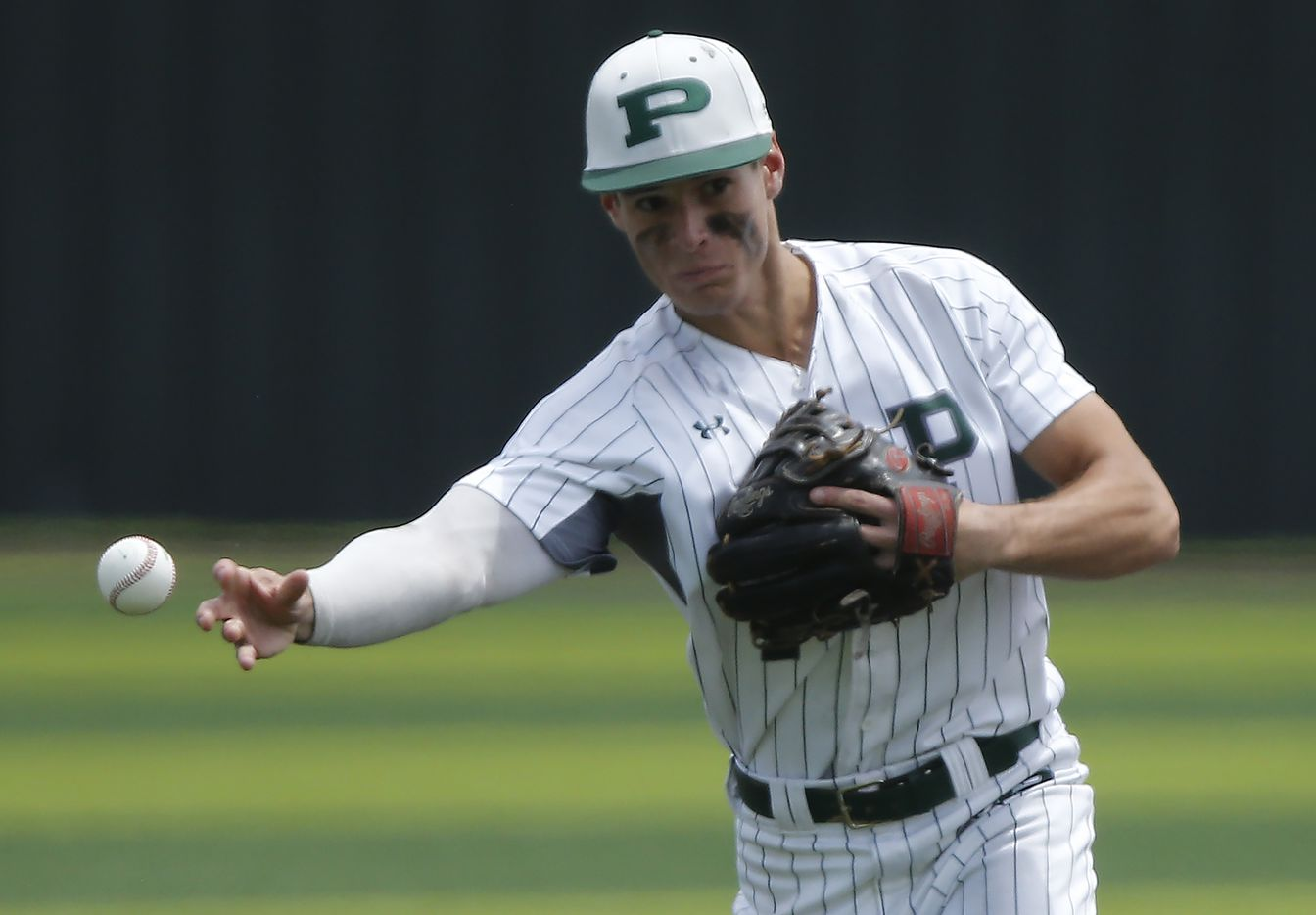 Prosper shortstop Chase Pendley (1) makes a throw to first base in the fourth inning as Prosper High School hosted Arlington Martin High School in a series final 6A Region I area round playoff game on Saturday afternoon, May 15, 2021. (Stewart F. House/Special Contributor)