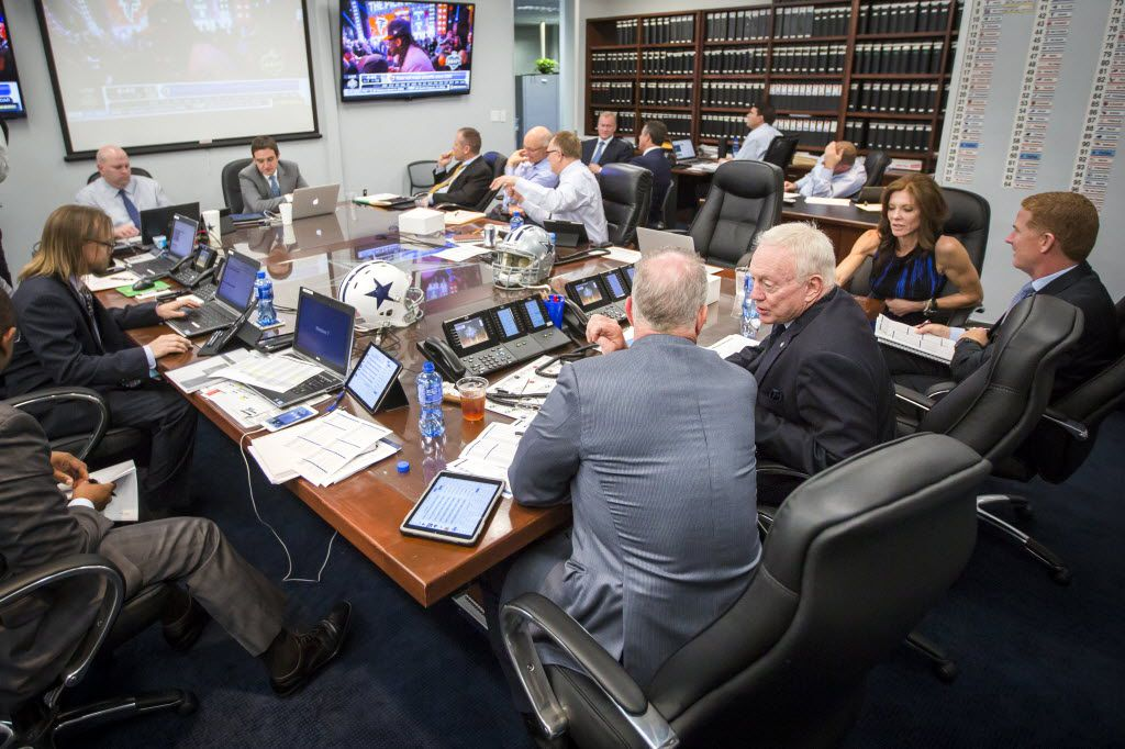 """Dallas Cowboys owner Jerry Jones (center) talks to his son, executive vice president/COO Stephen Jones, in the team's """"War Room"""" at their training facility at Valley Ranch on the first day of the NFL Draft, Thursday, April 30, 2015, in Irving, Texas.  Head coach Jason Garrett talks with Charlotte Jones Anderson, the team's executive vice president, at right. (Smiley N. Pool/The Dallas Morning News)  -- MANDATORY CREDIT; NO SALES; MAGS OUT; TV OUT; INTERNET USE BY AP MEMBERS ONLY"""