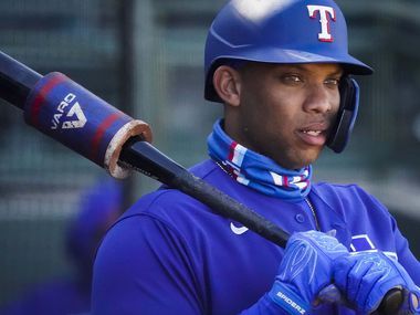 Texas Rangers infielder Curtis Terry waits in the on deck circle during the sixth inning of a spring training game against the Kansas City Royals at Surprise Stadium on Sunday, Feb. 28, 2021, in Surprise, Ariz. (Smiley N. Pool/The Dallas Morning News)