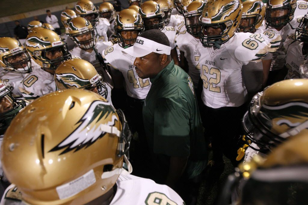 TXHSFB Desoto head coach Claude Mathis talks to his team before the start of the football game between Desoto High School and South Grand Prairie High School in Grand Prairie, Texas, Friday, October 17, 2014. Mike Stone/Special Contributor