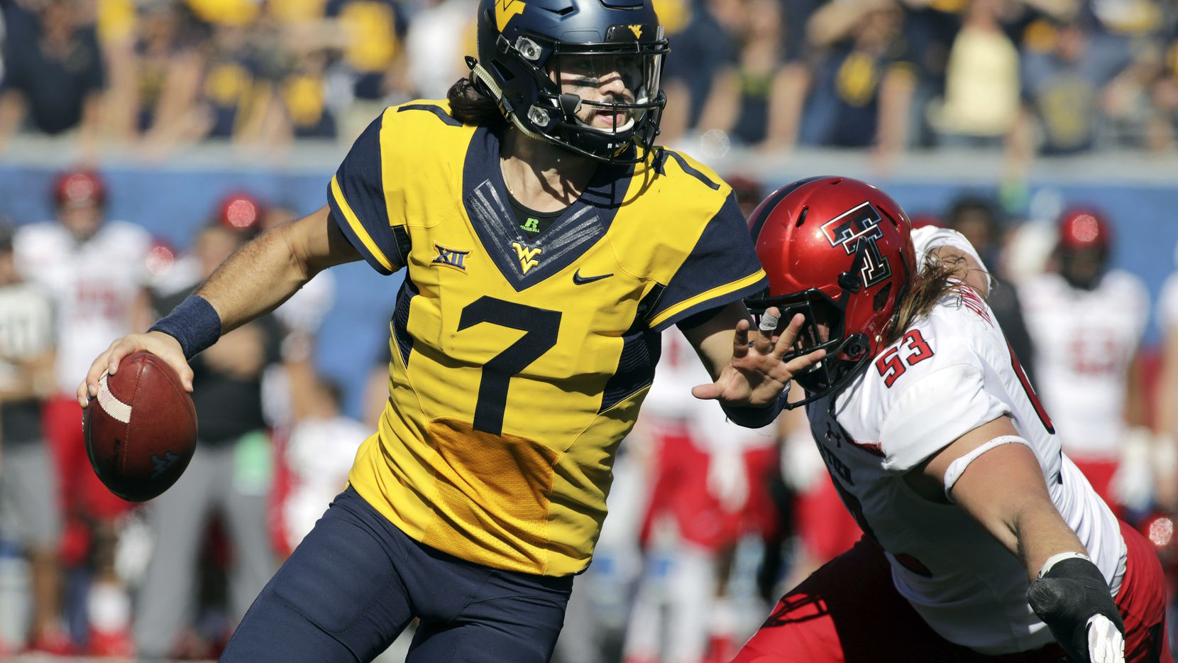 FILE - West Virginia quarterback Will Grier (7) scrambles to avoid a sack by Texas Tech defensive lineman Eli Howard (53) during the second half of a game on Saturday, Oct. 14, 2017, in Morgantown, W.Va. (AP Photo/Raymond Thompson, File)