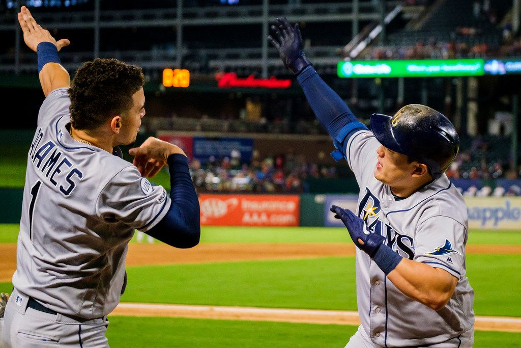 Tampa Bay Rays first baseman Ji-Man Choi celebrates with shortstop Willy Adames (1) after hitting a 3-run home run to tie the game at 7-7 in the top of the second inning at Globe Life Park on Wednesday, Sept. 11, 2019, in Arlington. (Smiley N. Pool/The Dallas Morning News)