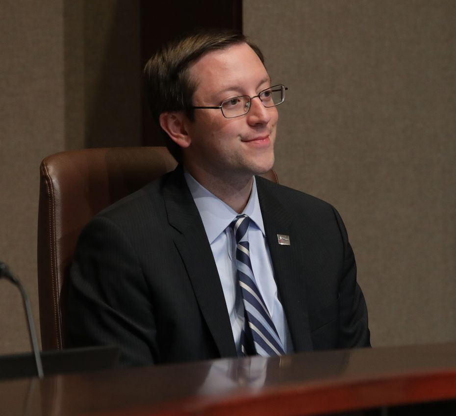 Plano city council member Anthony Ricciardelli listens to community members during a city council meeting in Plano, TX, on Aug. 12, 2019.