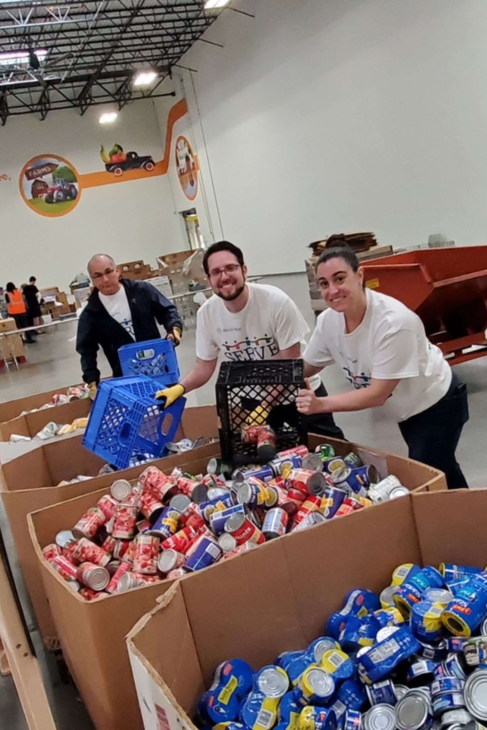 Fannie Mae employees give back to their community at the North Texas Food Bank during 7 Days to SERVE, the company's annual week of service.