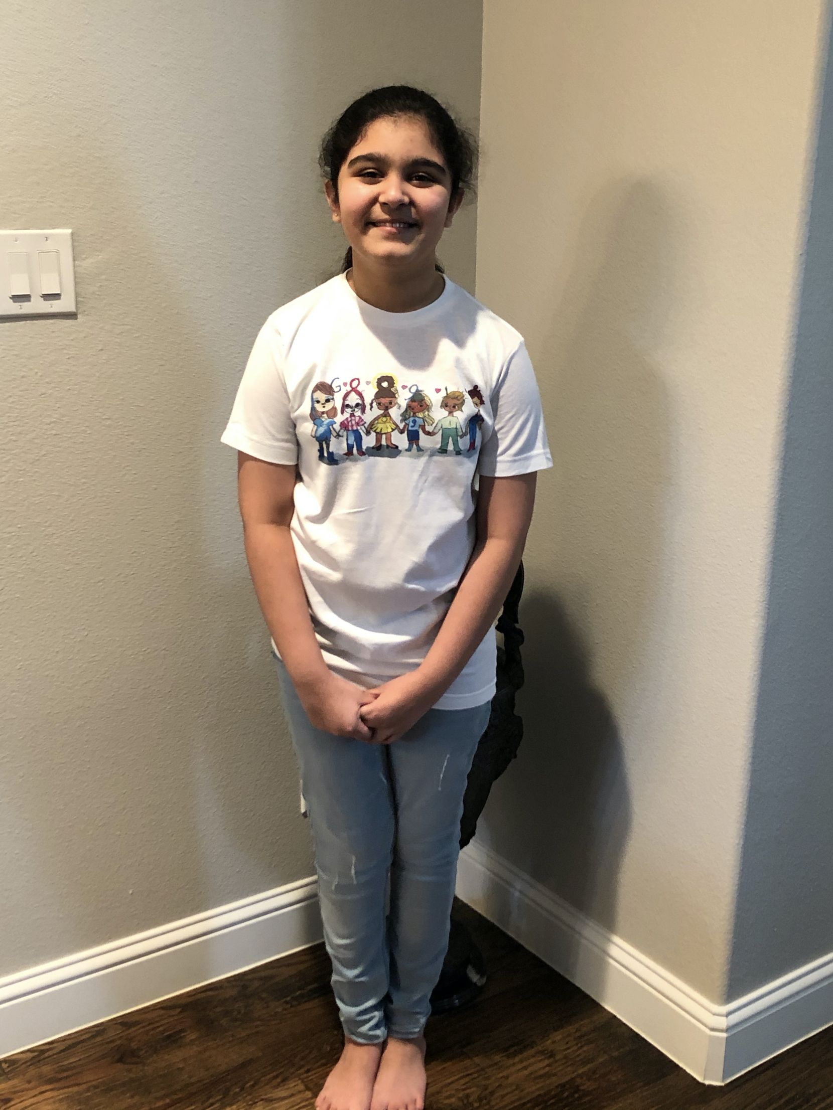 Frisco fifth-grader Sharon Sara wears a shirt featuring her doodle, which will be seen on Google's homepage.