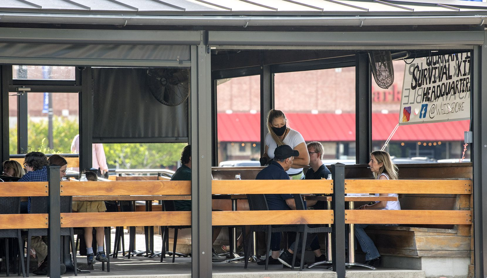 Patrons dine on the outdoor patio at Whiskey Cake Kitchen & Bar on Friday, May 1, 2020 in Plano, Texas.