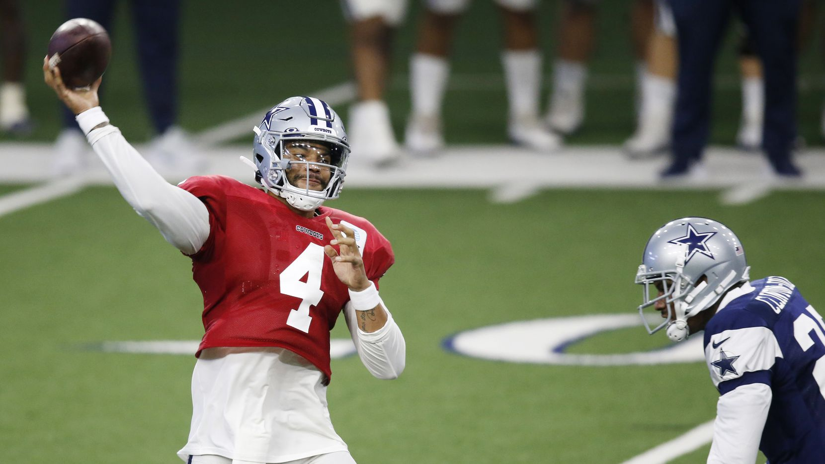 Dallas Cowboys quarterback Dak Prescott (4) attempts a pass as Dallas Cowboys safety Ha Ha Clinton-Dix (27) rushes him during training camp inside the Ford Center at the Dallas Cowboys headquarters at The Star in Frisco, Texas on Tuesday, August 18, 2020.