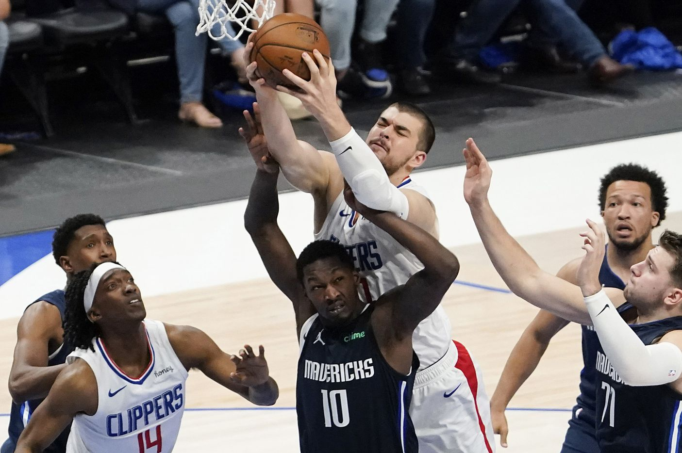LA Clippers center Ivica Zubac (40) grabs a rebound over Dallas Mavericks forward Dorian Finney-Smith (10) during the third quarter of an NBA playoff basketball game at American Airlines Center on Friday, May 28, 2021, in Dallas.