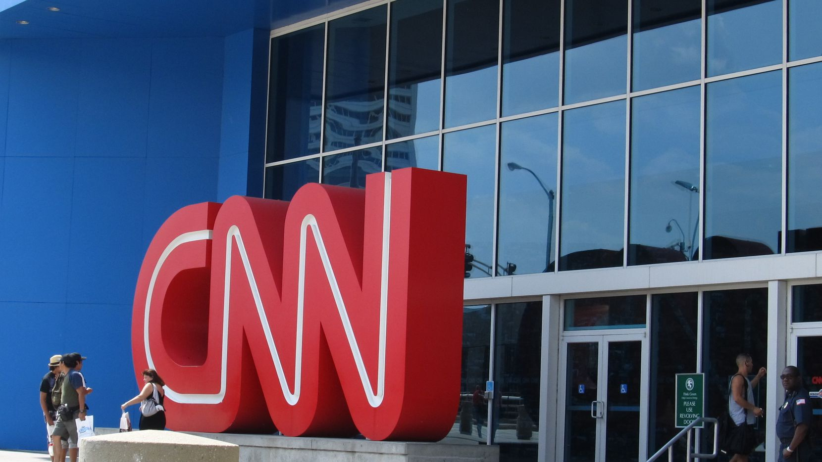 """A photo of the entrance to the CNN headquarters in downtown Atlanta. Some visitors trying to access CNN.com Tuesday got a message that said: """"Fastly error: unknown domain: cnn.com."""""""