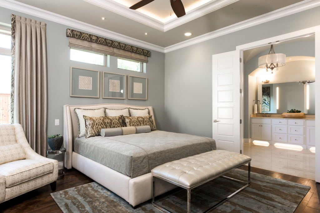 Dallas-based interior designer Barbara Gilbert wanted to provide a relaxing master suite where the homeowner of this room could  relax, read a book or watch TV,  she says. For instant sophisticated art, she framed metallic patterned prints matched to the room s neutral palette.