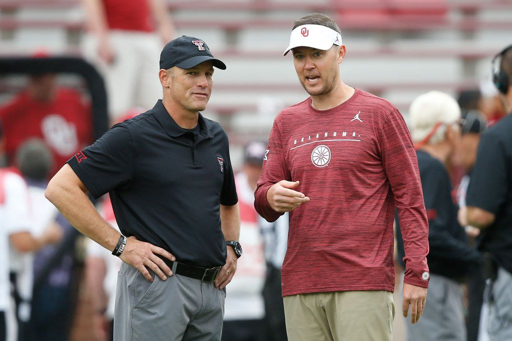 Texas Tech head coach Matt Wells, left, talks with Oklahoma head coach Lincoln Riley, right, before an NCAA college football game in Norman, Okla., Saturday, Sept. 28, 2019.