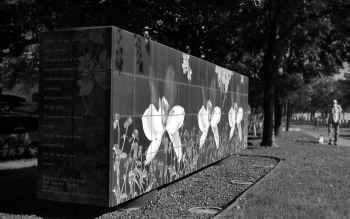 Above: Carolyn Brown's Paradise Garden Wall  sits on the Leonard Street median in front of Hotel Zaza. The wall's ceramic tiles feature images of Texas plants alongside verse by Paul Laurence Dunbar.