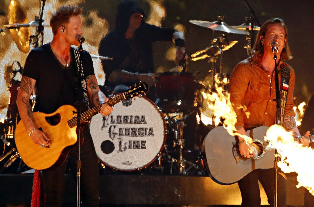 Florida Georgia Line perform during the 2015 Academy of Country Music Awards Sunday, April 19, 2015 at AT&T Stadium in Arlington, Texas.