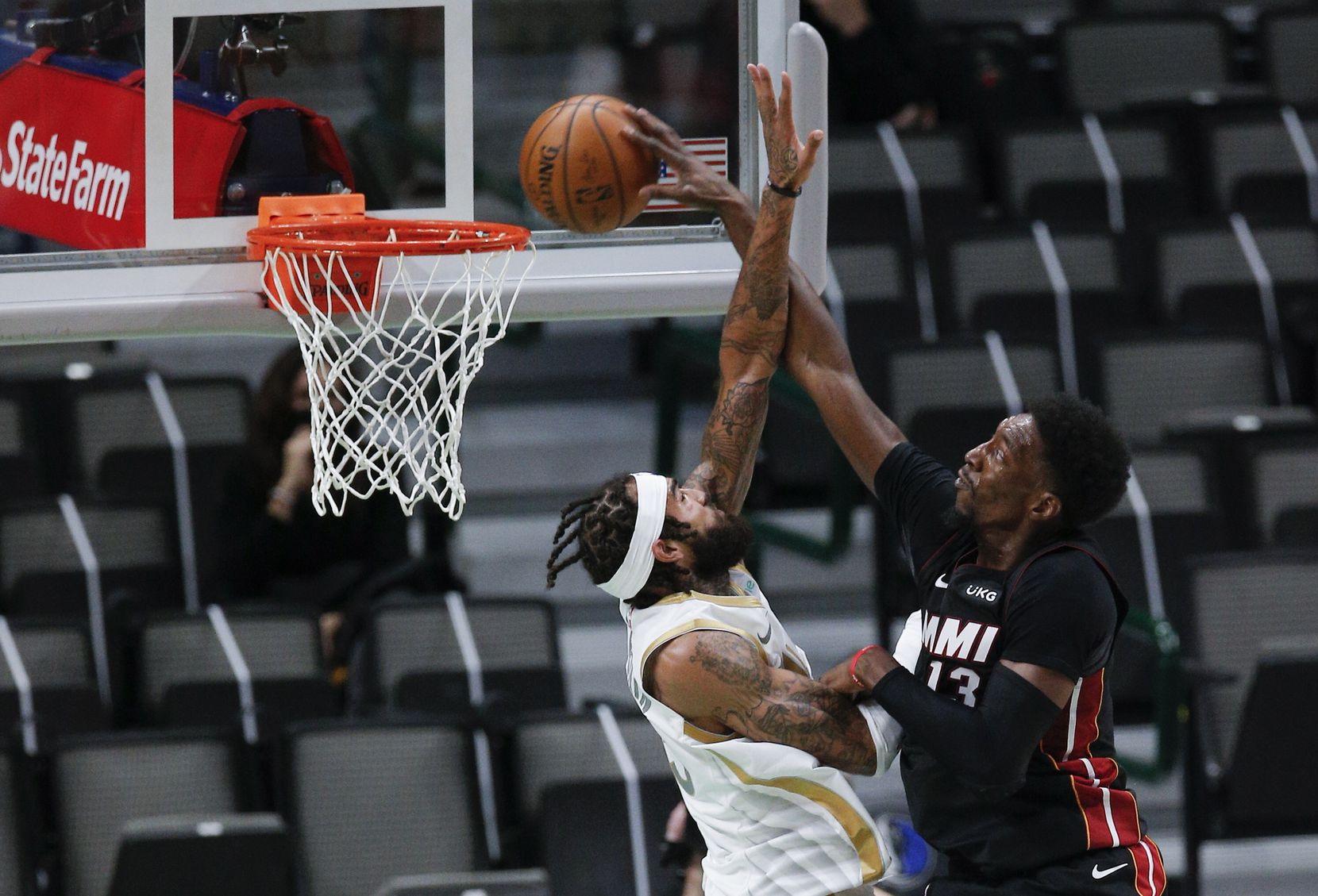 Miami Heat forward Bam Adebayo (13) is fouled by Dallas Mavericks forward Willie Cauley-Stein (33) during the first half of an NBA basketball game, Friday, January 1, 2021. (Brandon Wade/Special Contributor)