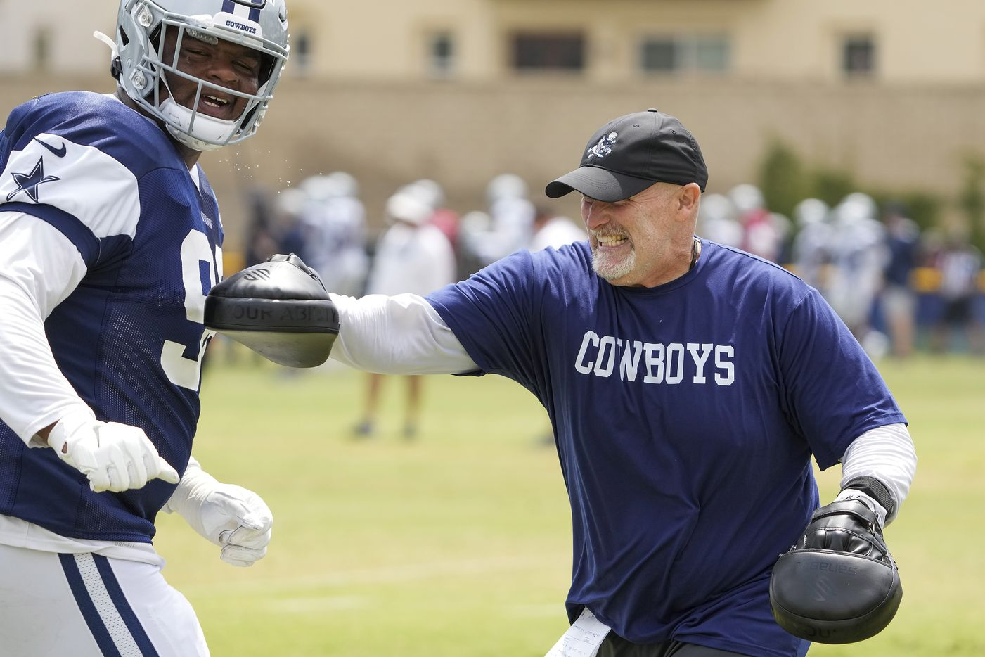 Dallas Cowboys defensive coordinator Dan Quinn works with defensive tackle Quinton Bohanna (98) during a practice at training camp on Wednesday, July 28, 2021, in Oxnard, Calif.