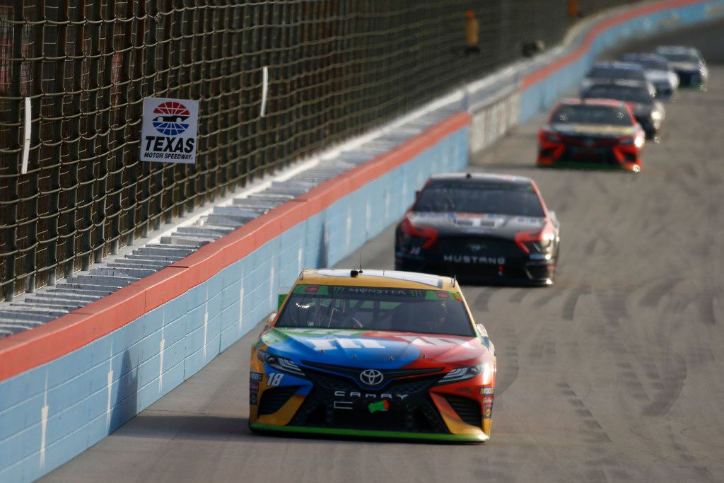 FORT WORTH, TEXAS - NOVEMBER 03: Kyle Busch, driver of the #18 M&M's Toyota, leads a pack of cars during the Monster Energy NASCAR Cup Series AAA Texas 500 at Texas Motor Speedway on November 03, 2019 in Fort Worth, Texas.