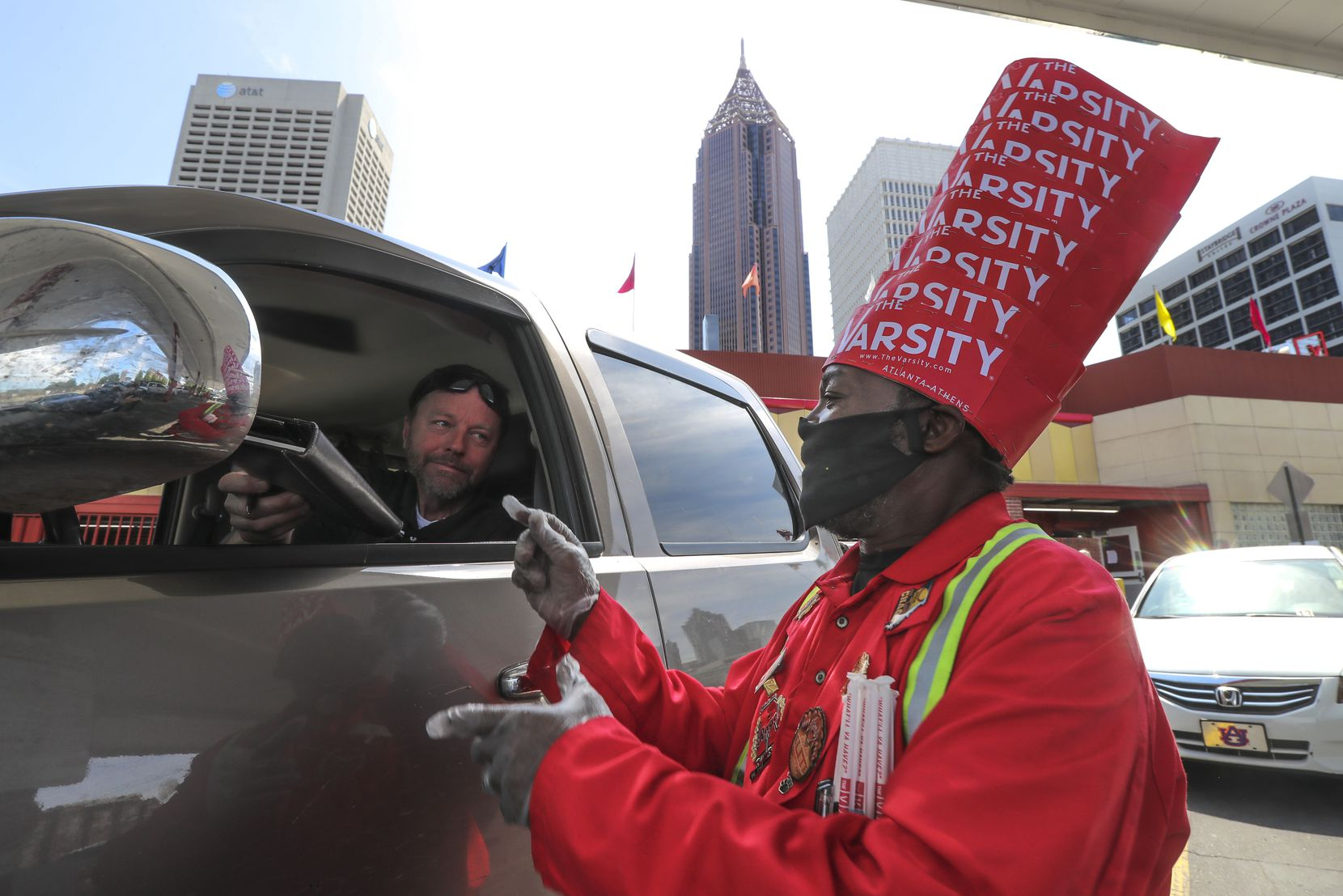 Customer Dave Williams handed over his signed bill to Fred Stewart on April 28, 2020, at the Varsity restaurant in downtown Atlanta.