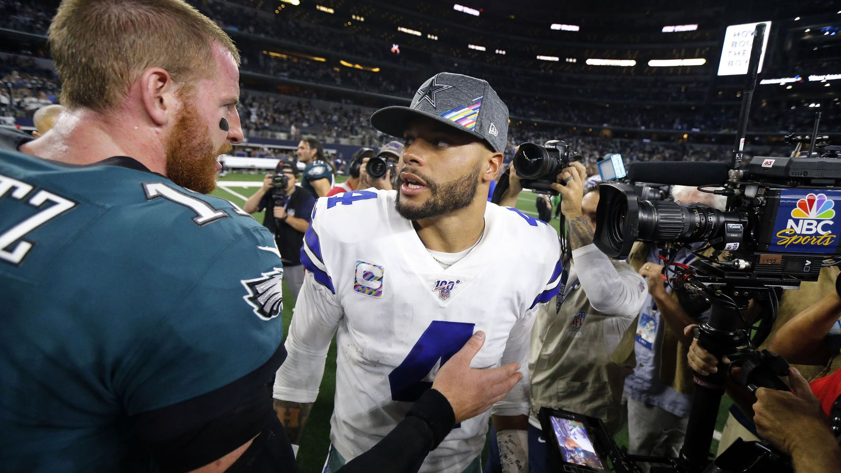 Philadelphia Eagles quarterback Carson Wentz (11) stops and congratulates Dallas Cowboys quarterback Dak Prescott (4) on their 37-10 win at AT&T Stadium in Arlington, Texas, Sunday, October 20, 2019. The Cowboys won, 37-10.