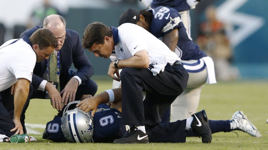 Dallas Cowboys quarterback Tony Romo (9) is tended to by Dallas Cowboys medical staff after getting injured during the third quarter of play at Lincoln Financial Field in Philadelphia, on Sunday, September 20, 2015. (Vernon Bryant/The Dallas Morning News)