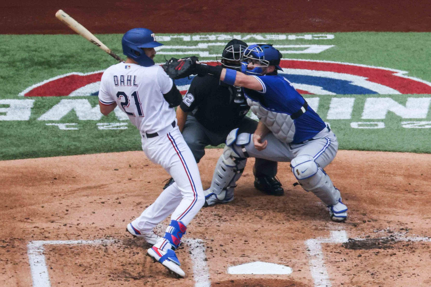 Texas Rangers's David Dahl No.21  dodges a ball in home plate at the Globe Life Field during opening day against Toronto Blue Jays in Arlington, Texas on Monday, April 5, 2021. (Lola Gomez/The Dallas Morning News)
