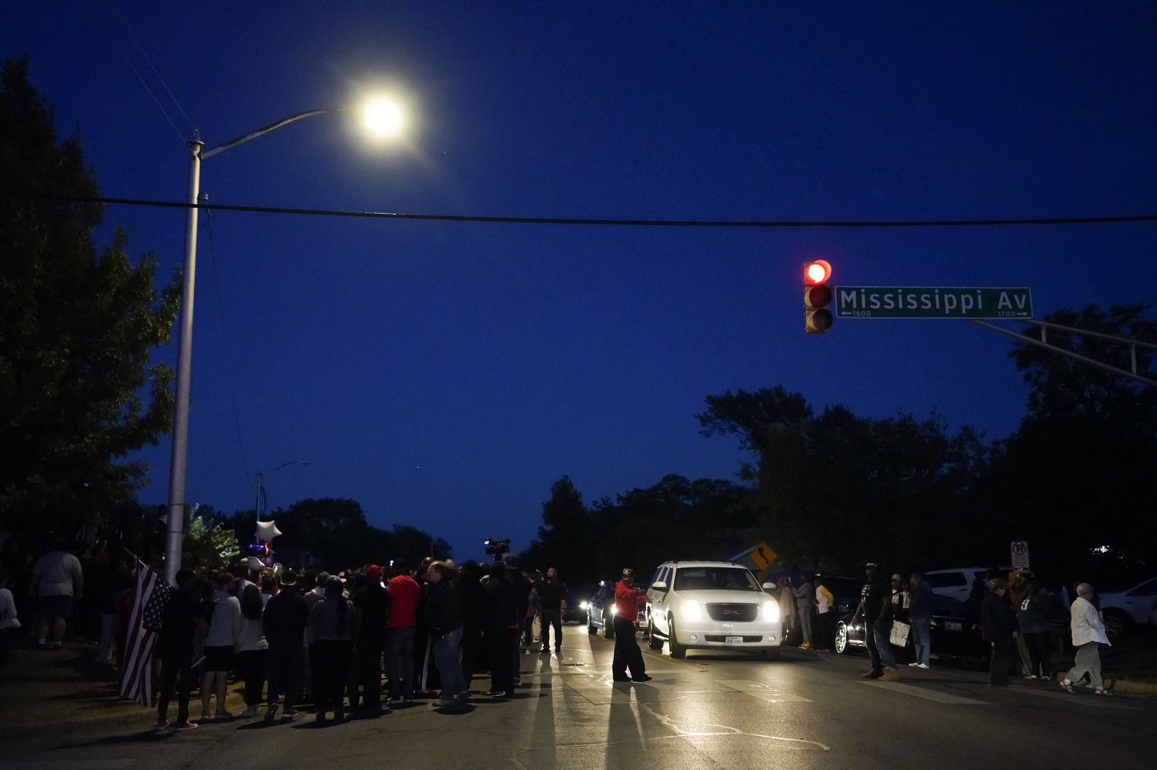 A large crowd of protestors gathers in the neighborhood where Atatiana Jefferson was shot and killed, during a community vigil for Jefferson on Sunday, Oct. 13, 2019, in Fort Worth.