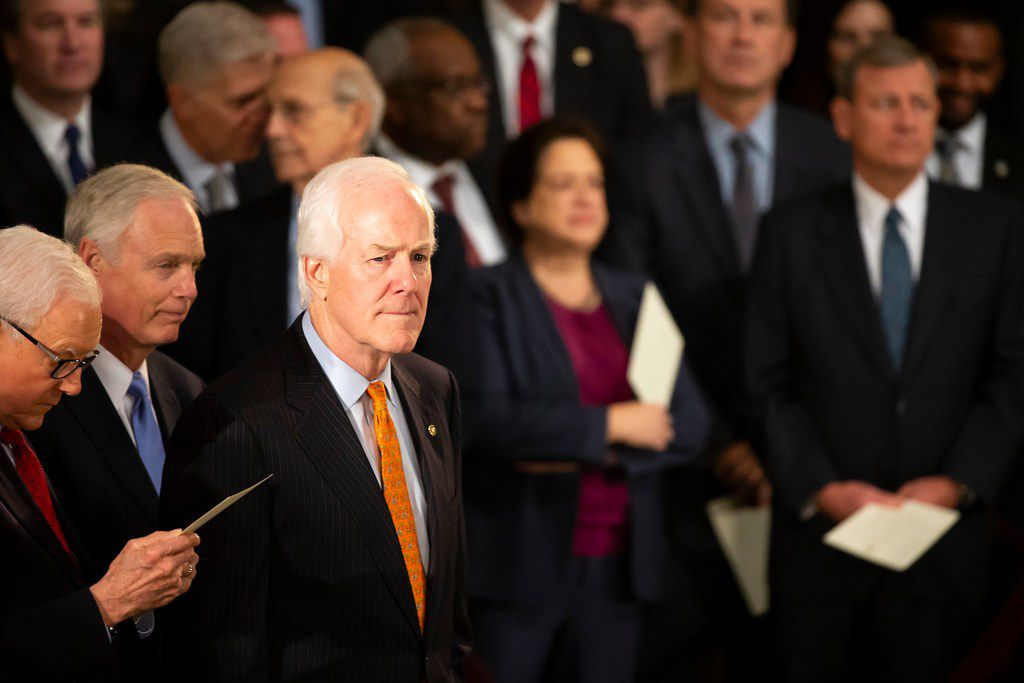 Sen. John Cornyn attends a ceremony to begin a period where President George H.W. Bush will lie in state in the Rotunda of the U.S. Capitol on Monday, Dec. 3, 2018, in Washington.