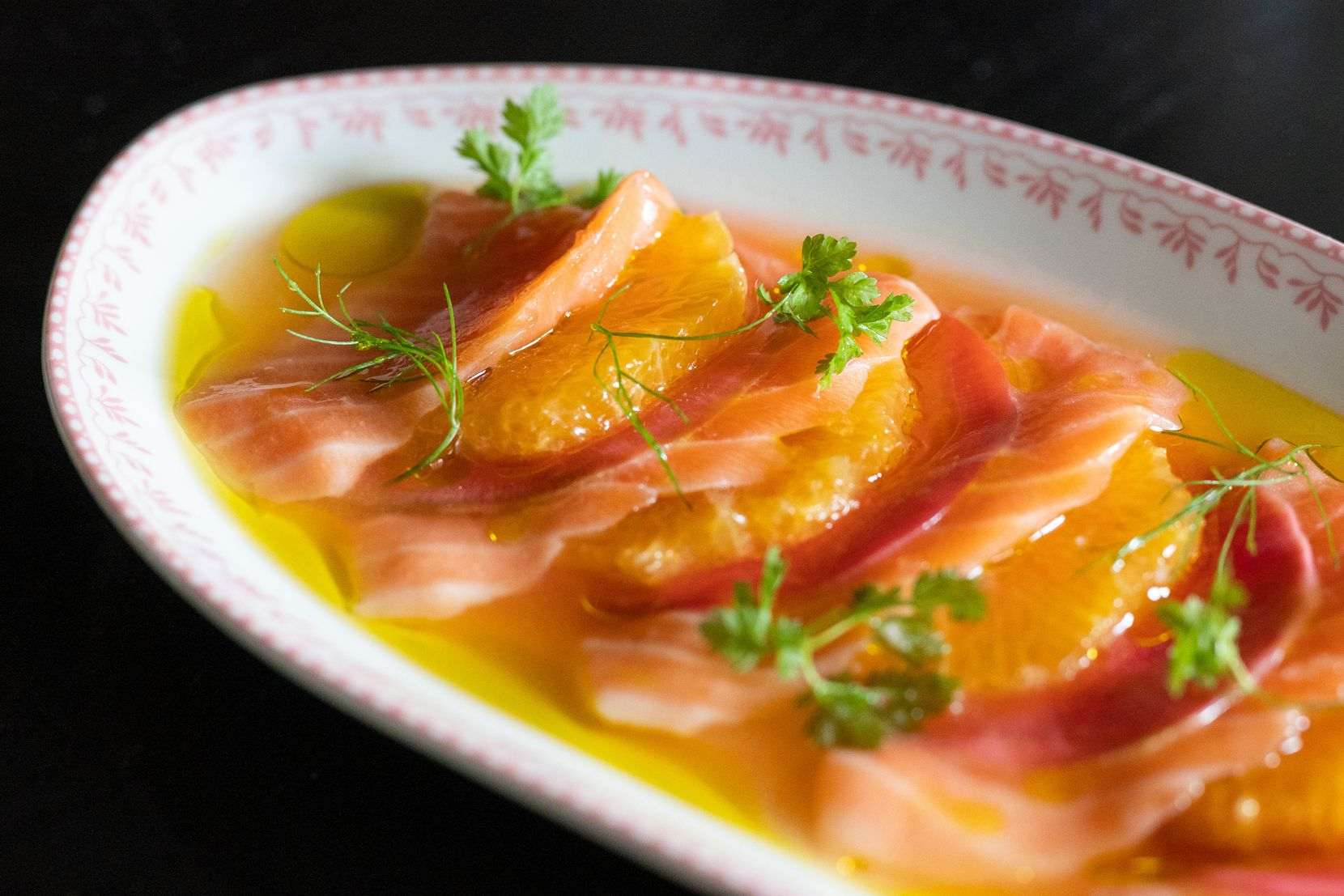 An aperitif of salmon, radish and orange blossom is bright and light.  Sister opened on Greenville Avenue in Dallas on September 28, 2021.