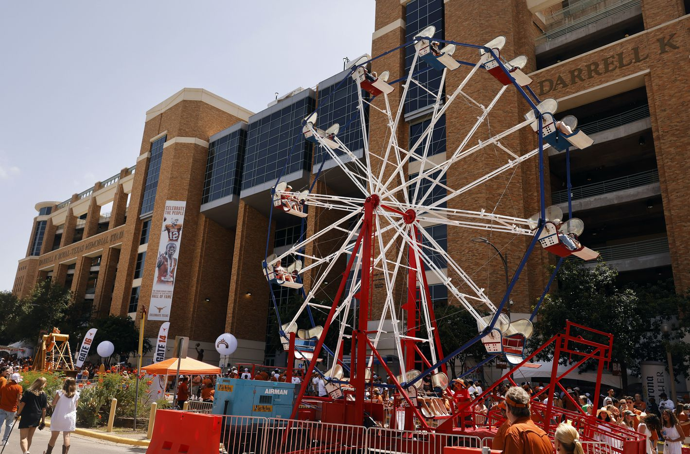 Fans ride the ferris wheel erected along Smokey's Midway outside of DKR-Texas Memorial Stadium in Austin, Saturday, September 4, 2021. The Longhorns were facing the Louisiana-Lafayette Ragin Cajuns. (Tom Fox/The Dallas Morning News)