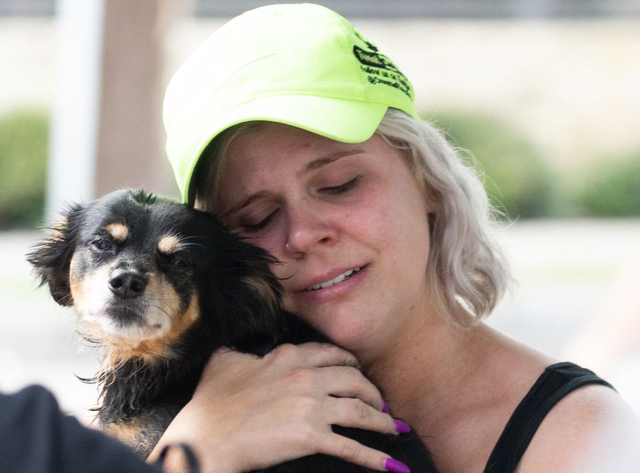 Corey Lark gets emotional after being reunited with her dog, George, after a crane collapsed into the Elan City Lights apartments in Dallas on Sunday, June 9, 2019.