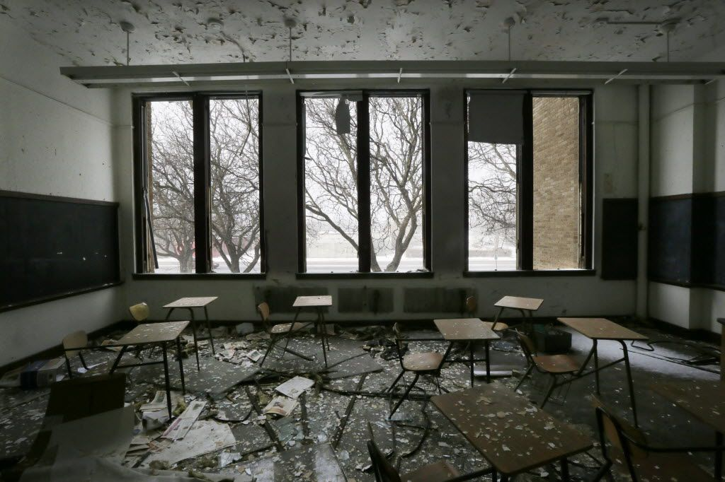 FILE- This file photo from Jan. 6, 2015, shows a vacant classroom at Southwestern High School in Detroit. Michigan lawmakers trying to glue together a plan to fix Detroit Public Schools using taxpayer money are staring down more than a decade of failure with what was once among the largest public education systems in the nation. (AP Photo/Carlos Osorio, File)