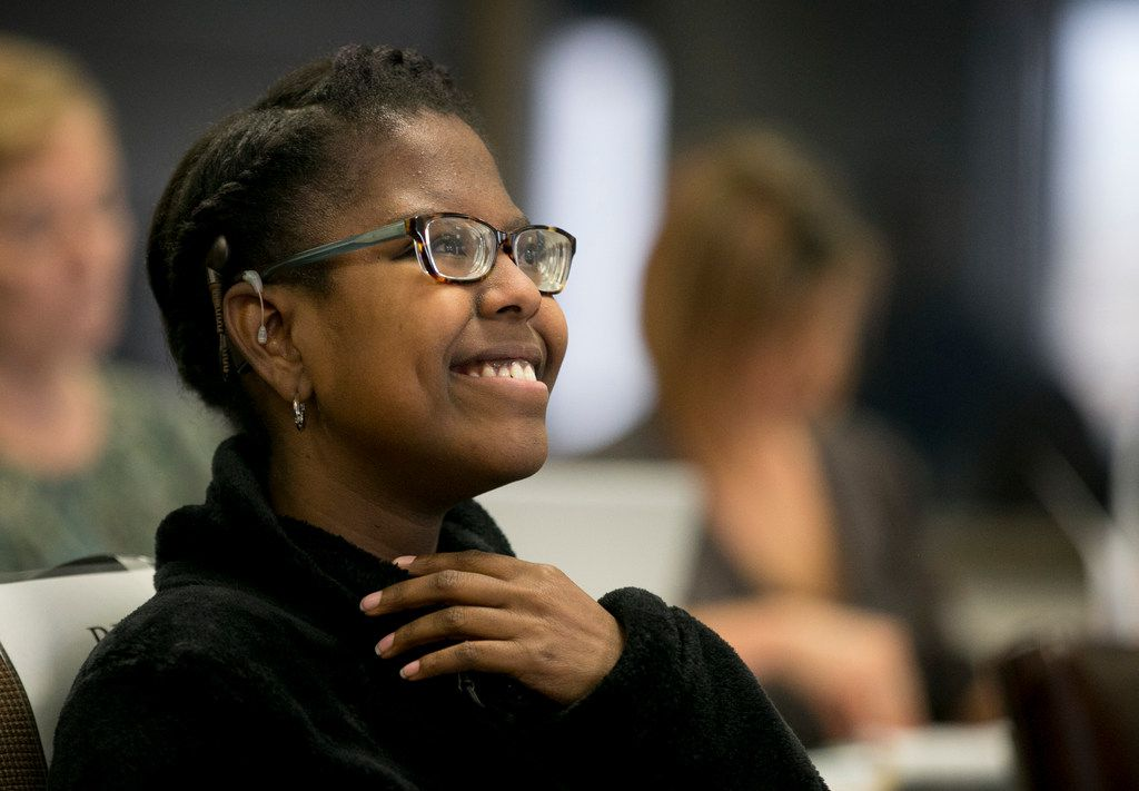 Gabby Caldwell, 17, who is deaf and blind, takes a seat after speaking in favor of keeping Helen Keller in the Texas social studies curriculum at the State Board of Education meeting in the William B. Travis Building on Tuesday November 13, 2018.    [JAY JANNER/AMERICAN-STATESMAN]