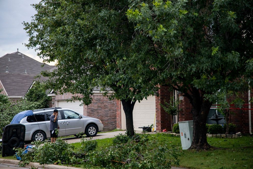 People work on cleaning up after a storm passed through Keller, Texas on Sunday, June 16, 2019.