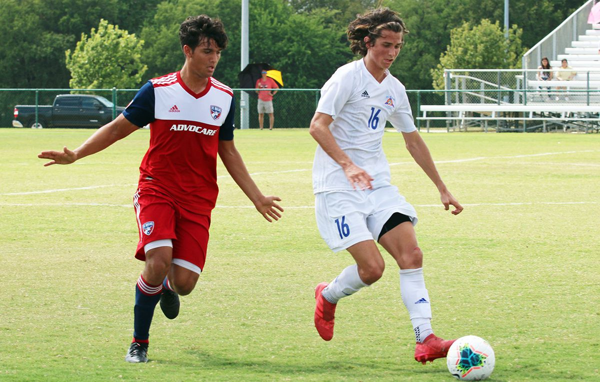 Nathan Toledo of the FC Dallas U19s defends Bailey Sparks of Solar SC.