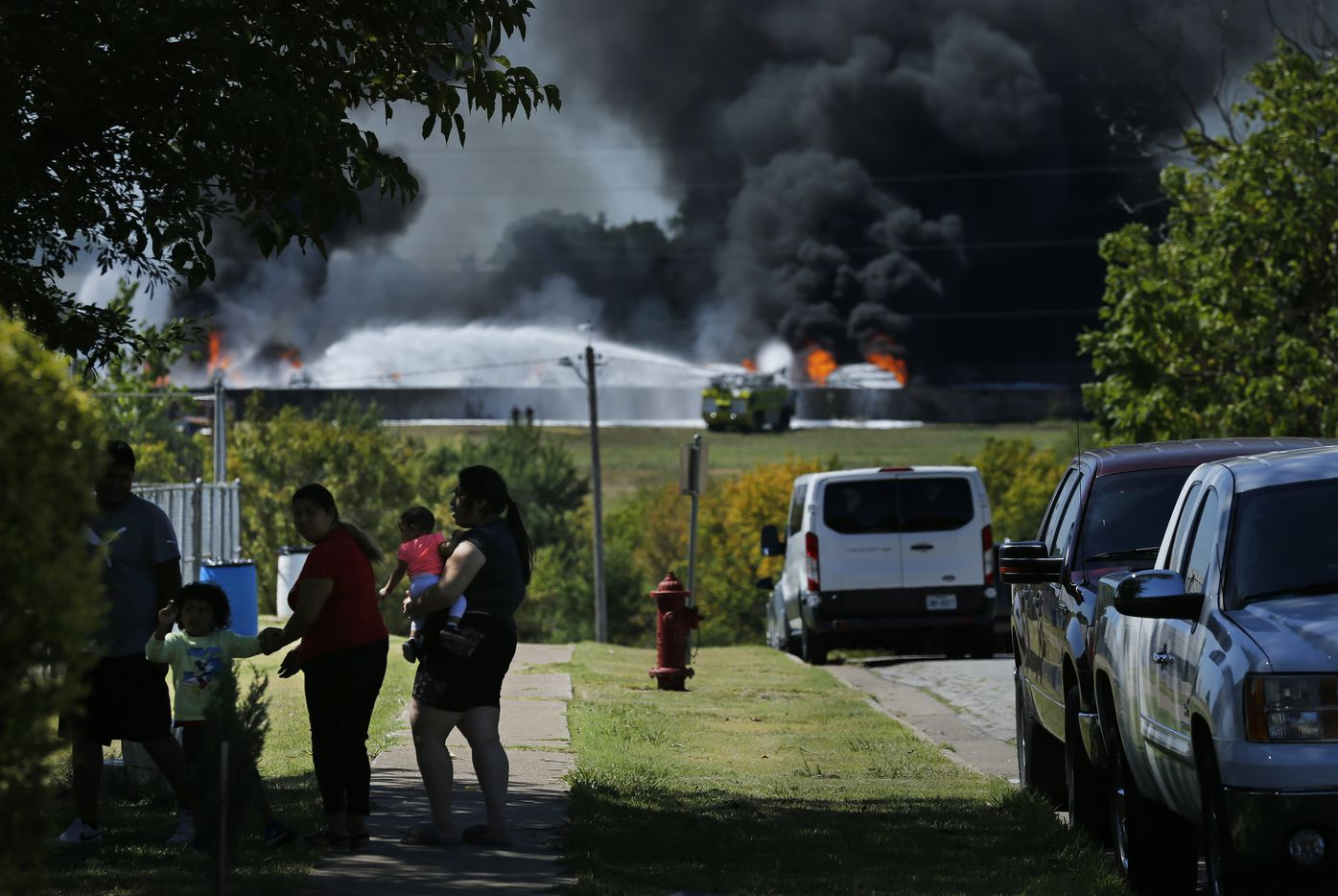Black smoke from burning plastic billows at Poly-America as nearby neighbors came out to check on the fire burning at 2000 West Marshall Drive in Grand Prairie, Texas, Wednesday, August 19, 2020.