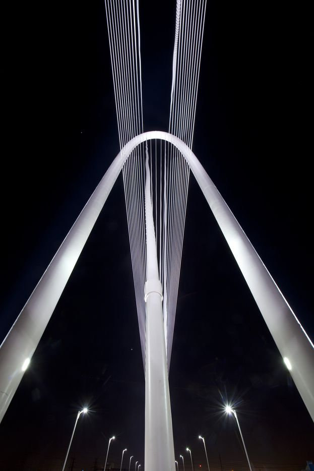 The high tension cables lead to the top of the Margaret Hunt Hill Bridge as it is seen at night, January 19, 2012.  World-renowned architect Santiago Calatrava designed the bridge. (Tom Fox/The Dallas Morning News)