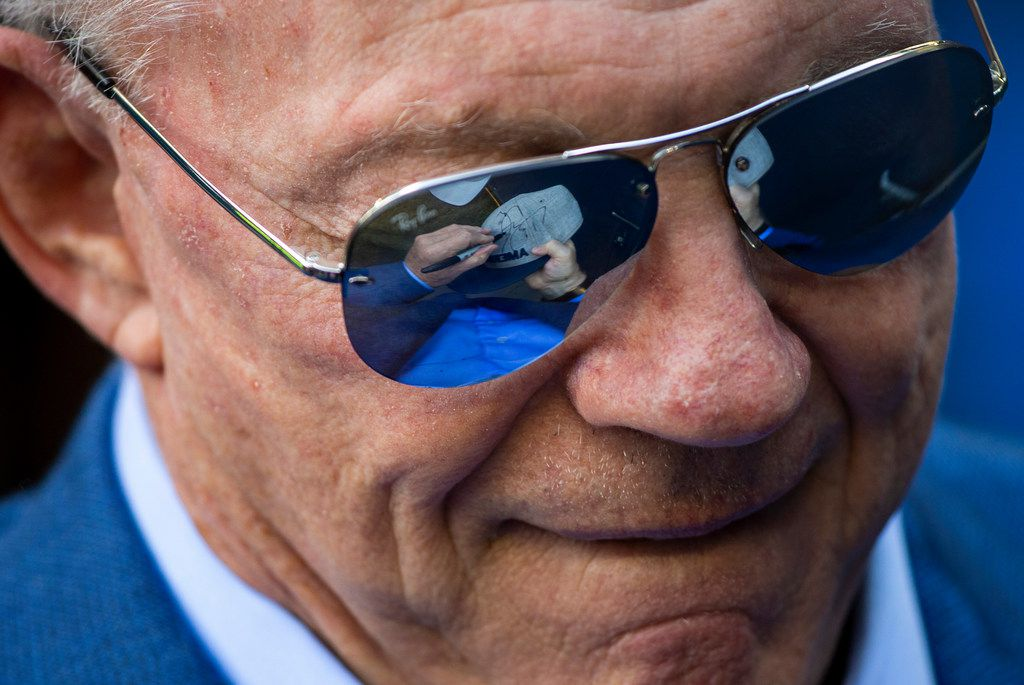 Dallas Cowboys owner Jerry Jones signs autographs for fans before an NFL football game against the Seattle Seahawks at CenturyLink Field on Sunday, Sept. 23, 2018, in Seattle. (Smiley N. Pool/The Dallas Morning News)