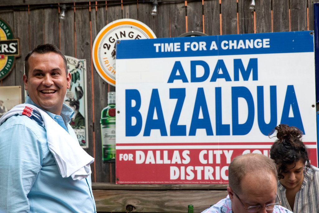 Adam Bazaldua, the candidate for District 7 member of the Dallas City Council, visits with supporters at his election-night watch party at Eight Bells Alehouse in Dallas on Saturday, June 8, 2019. (Lynda M. Gonzalez/The Dallas Morning News)