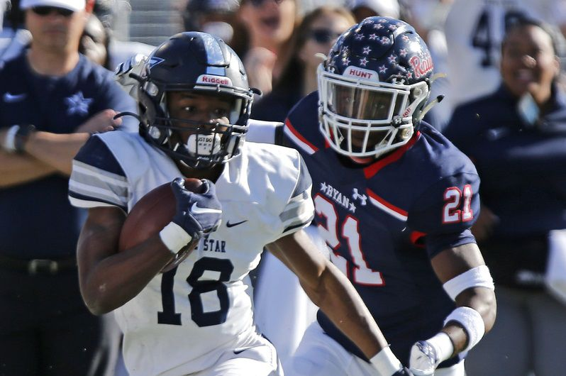 Lone Star High School wide receiver Marvin Mims (18) runs after a catch in front of Denton Ryan High School linebacker D.J. Arkansas (21) during the first half as Frisco Lone Star High School played Denton Ryan High School in a Class 5A Division I state semifinal game at Eagle Stadium in Allen on Saturday, December 14, 2019. (Stewart F. House/Special Contributor)
