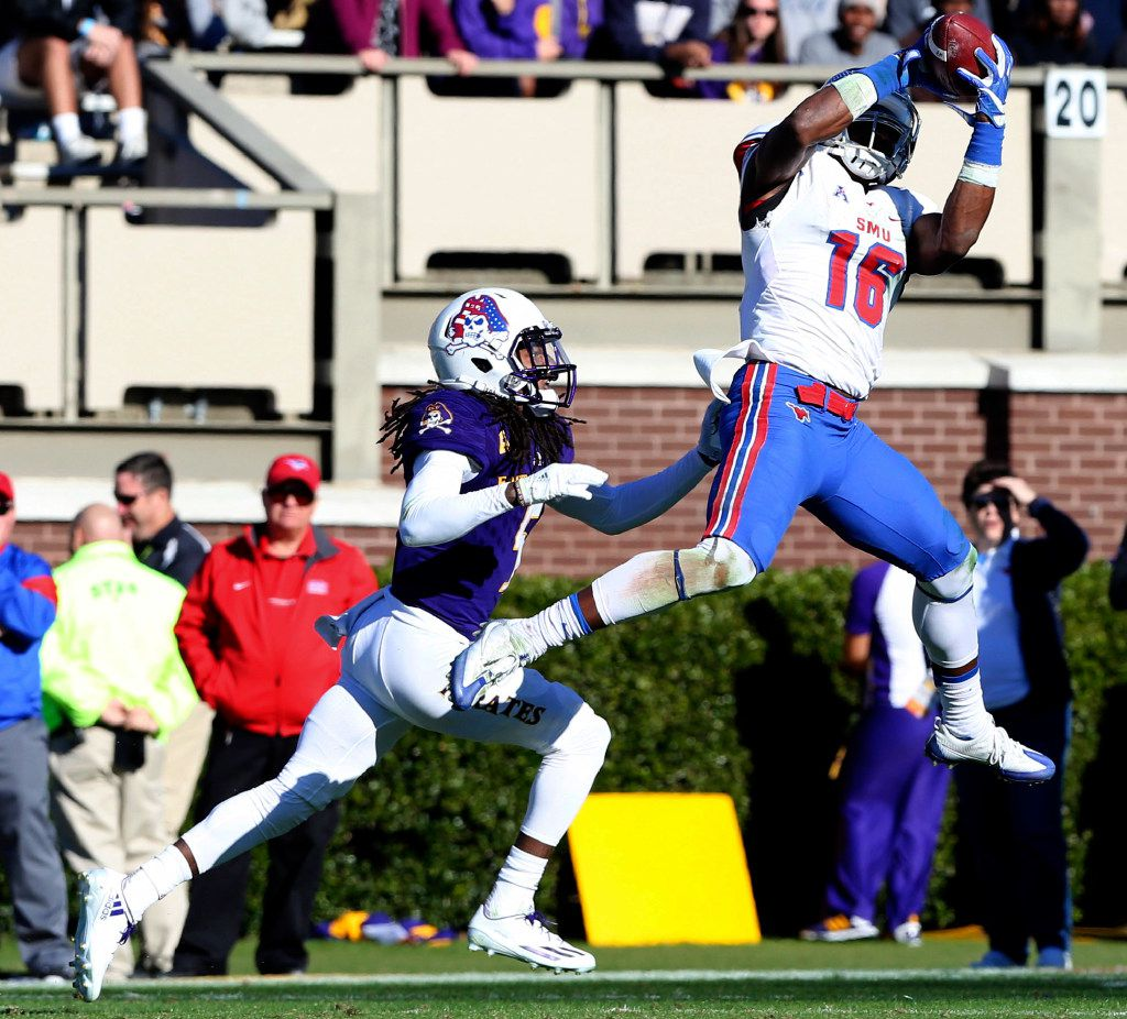 SMU's Courtland Sutton catches a pass in front of East Carolina's Corey Seargent  during the first half of an NCAA college football game, Saturday, Nov. 12, 2016, at Dowdy-Ficklen Stadium in Greenville, N.C.  ( Rhett Butler/The Daily Reflector via AP)