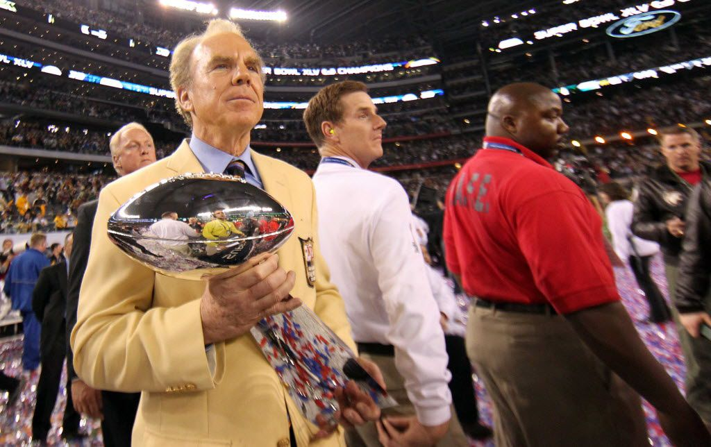 Roger Staubach presents the Vince Lombardi Trophy after Super Bowl XLV between the Green Bay Packers and the Pittsburgh Steelers at Cowboys Stadium.