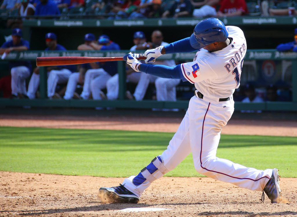 ARLINGTON, TX - JULY 10: Jurickson Profar #19 of the Texas Rangers hits a solo home run in the ninth inning against the Minnesota Twins at Globe Life Park in Arlington on July 10, 2016 in Arlington, Texas. (Photo by Rick Yeatts/Getty Images)