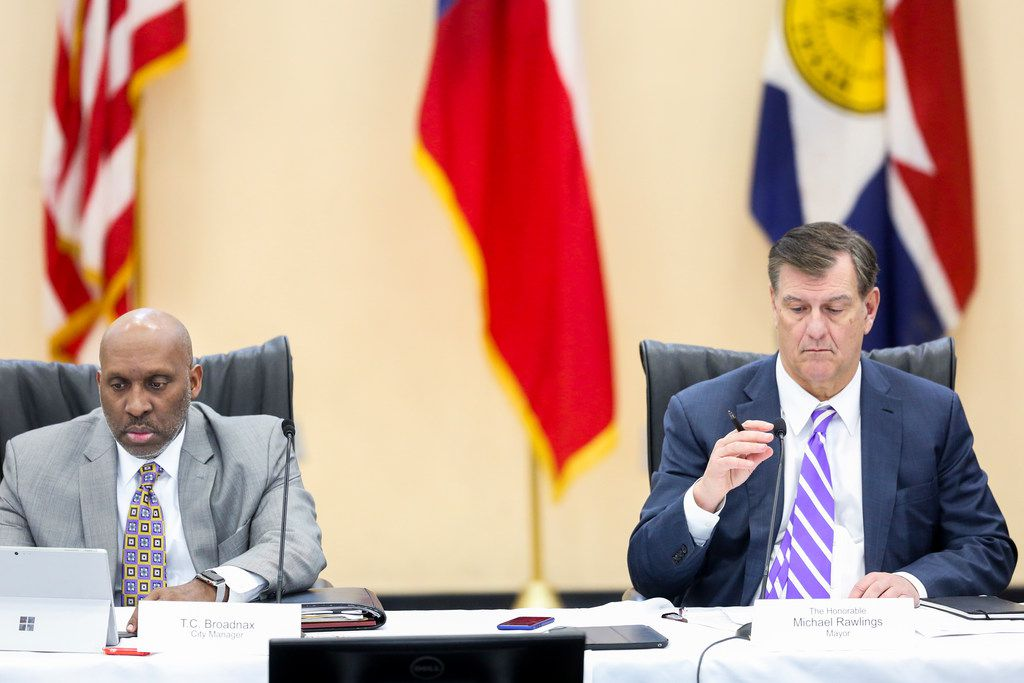 Dallas City Manager T.C. Broadnax, left, listens along with  Mayor Mike Rawlings, right, during a Dallas City Council meeting at Park In the Woods Recreation Center in Dallas on Wednesday, Feb. 13, 2019.