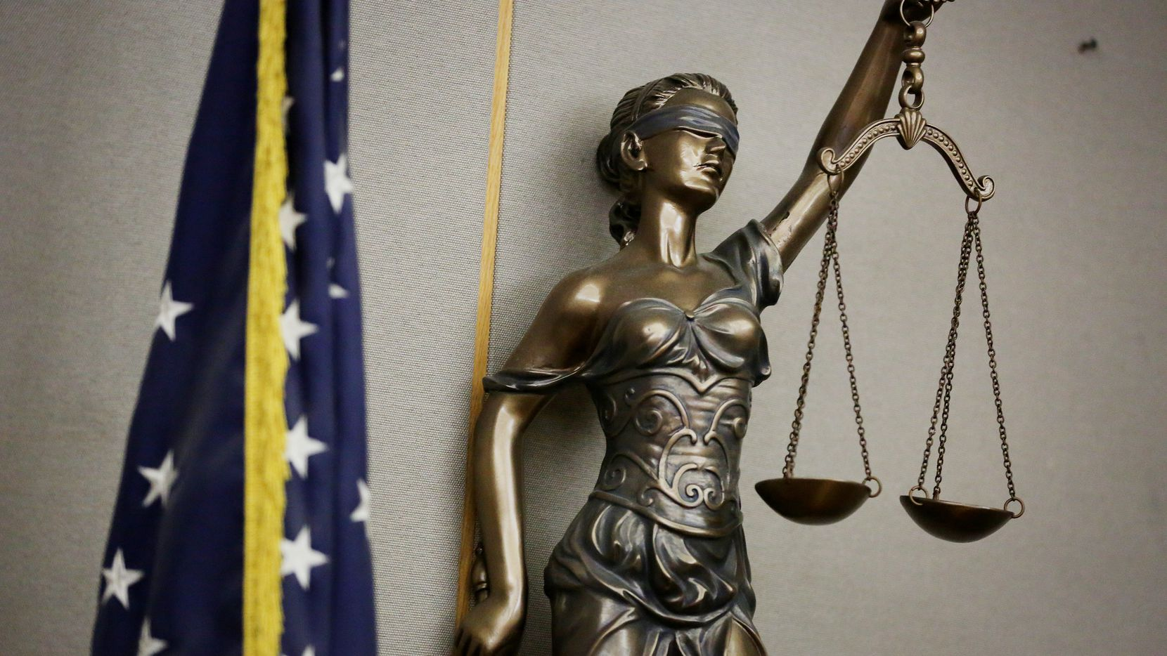 File image of a statue of Lady Justice in a courtroom in the Frank Crowley Courts Building in Dallas.