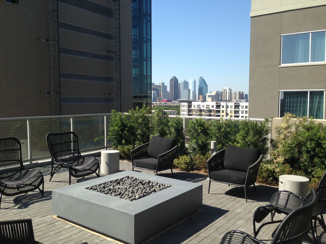 A fire pit at the Ardan tower comes with a view of the Dallas skyline.