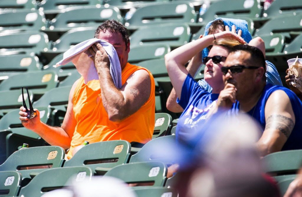 A sweaty Texas Rangers fan towels off in the sizzling section of Globe Life Park in Arlington.